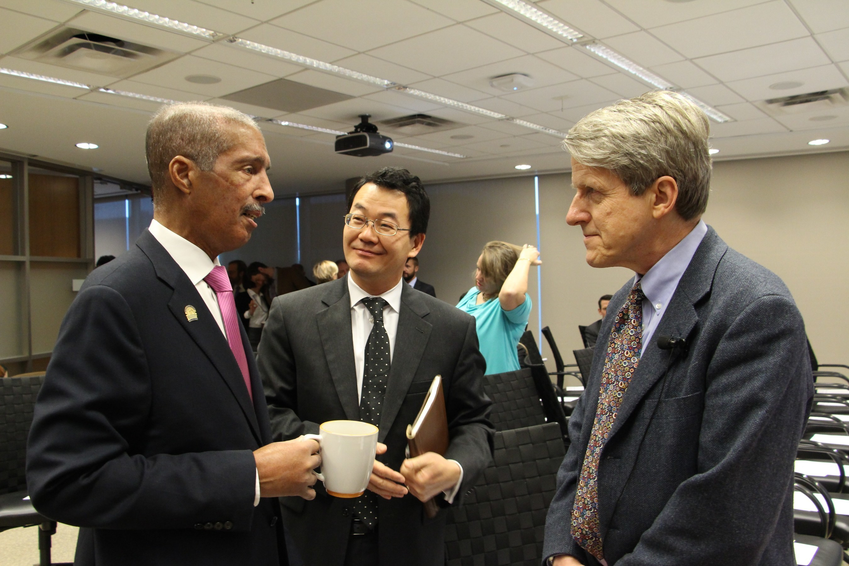 NAR president William E. Brown talks with NAR Chief Economist Lawrence Yun and Dr. Robert Shiller
