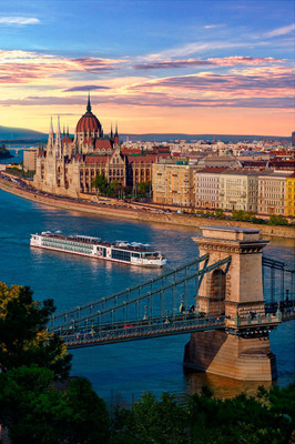 A Viking Longship sails past the Hungarian Parliament Building in Budapest. Seventeen Viking ships were recently ranked in top spots on Conde Nast Traveler's 2014 Cruise Poll, including three of Viking's new Longships debuting on the poll for the first time. The Viking Longship Odin was also named the #1 top-ranking river cruise ship in the readers' poll. For more information, visit www.vikingcruises.com.  (PRNewsFoto/Viking Cruises)