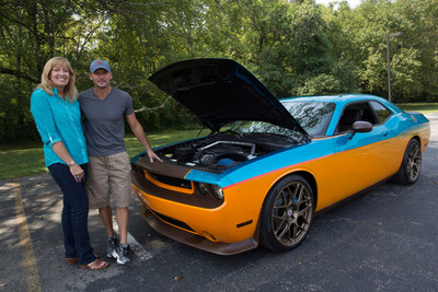Country superstar, Tim McGraw, handed over the keys to a personally customized 2013 Challenger SRT8 on Monday, September 16, 2013, as part of the Pennzoil(R) 'Four Wheels to Freedom' sweepstakes to Kentucky resident, April Vaught. (Photo Credit: Pennzoil/Thien Phan).  (PRNewsFoto/Pennzoil)