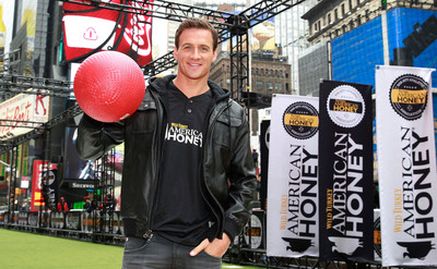Eleven-time Olympic medalist and TV star Ryan Lochte throws first pitch at American Honey Bar-sity Athletics kickball game in Times Square, on Tuesday, April, 23, 2013 in New York City, New York. (Photo by Mark Von Holden/Invision for American Honey/AP Images).  (PRNewsFoto/Campari America)