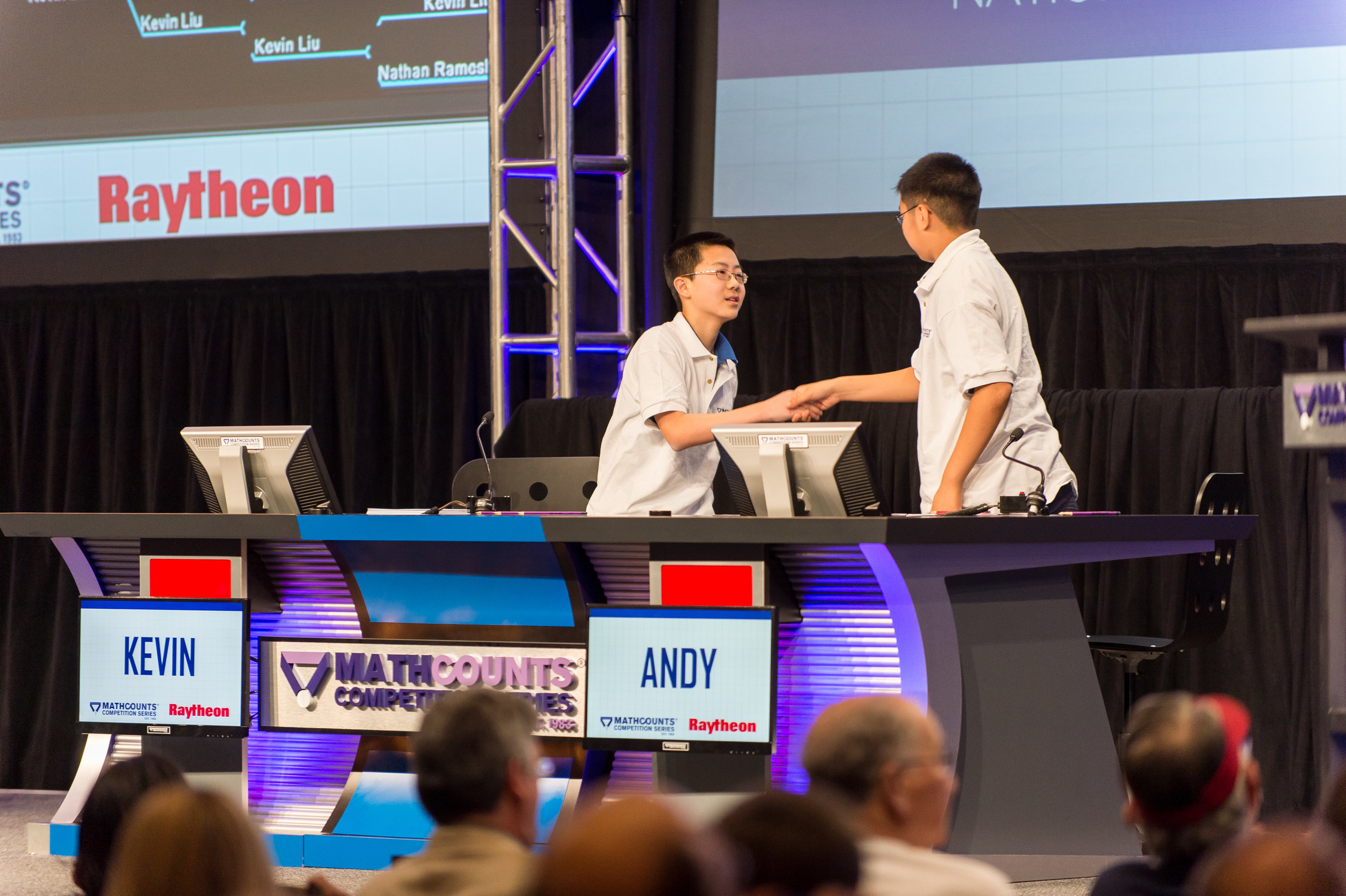 Kevin Liu, left, the 2015 Raytheon MATHCOUNTS National Champion, shakes the hand of runner-up Andy Xu after the final question of the Countdown Round at the Sheraton Boston Hotel. Liu, 14, of Carmel, Indiana, was among 224 U.S. middle-school math students who took part in this year's competition.