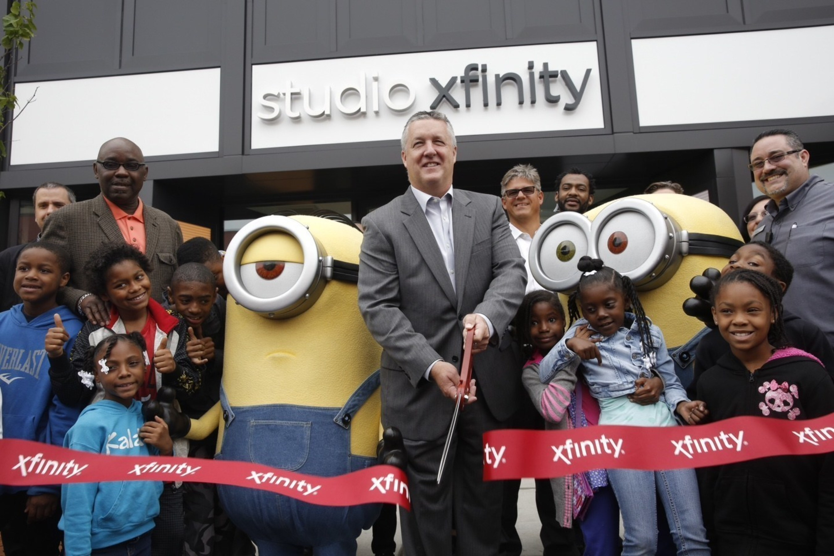 The Minions joined Comcast regional senior vice president John Crowley to  cut the ribbon at the