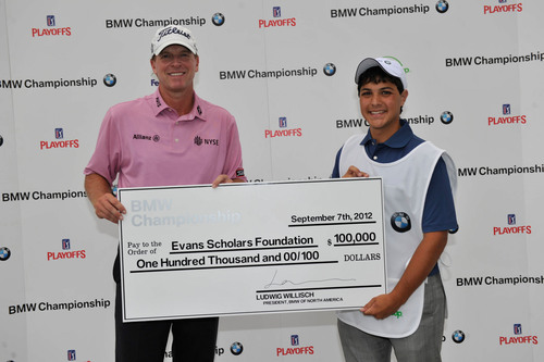 PGA TOUR Pro Steve Stricker poses with Evans Scholar Justin Cruz after BMW presented a $100,000 scholarship to the Evans Scholars Foundation at the 2012 BMW Championship in Carmel, IN on Friday September 7, 2012.  BMW awarded the scholarship because PGA TOUR Pro Steve Stricker hit a hole-in-one on Crooked Stick's sixth hole during the second round of play.  [From L to R: PGA TOUR pro Steve Stricker, Evans Scholar Justin Cruz.].  (PRNewsFoto/BMW of North America, LLC, Rick Sanchez/WGA)