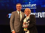 Argent Associates President and CEO, Betty Manetta, being presented the 2016 Global Sustainability Award for Most Improved from QuEST Forum CEO, Fraser Pajak