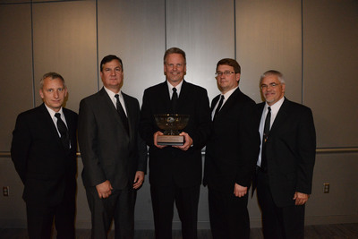Members of Cirrus Aircraft's SR-series Engineering and Design Team accepted the 2013 Joseph T. Nall Safety Award at an awards dinner during the annual conference of the International Air & Transportation Safety Bar Association, in Pensacola, Fla. Pictured left to right are Mike Stevens, Chief Test Pilot; Paul Brey, Senior Vice President, Product Development; Dale Klapmeier, Co-Founder & CEO; Paul Johnston, Chief Engineer; and Bill King, Vice President, Business Administration.  (PRNewsFoto/Cirrus Aircraft)