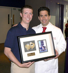 On May 9, 2012, Jordan Merecka presented his surgeon Dr. David L.S. Morales with the SynCardia temporary Total Artificial Heart that kept him alive for 160 days until he received a donor heart transplant on Oct. 29, 2011. Jordan was the first of three consecutive pediatric patients bridged to transplant with the Total Artificial Heart during a six-month period.  (PRNewsFoto/SynCardia Systems, Inc.)