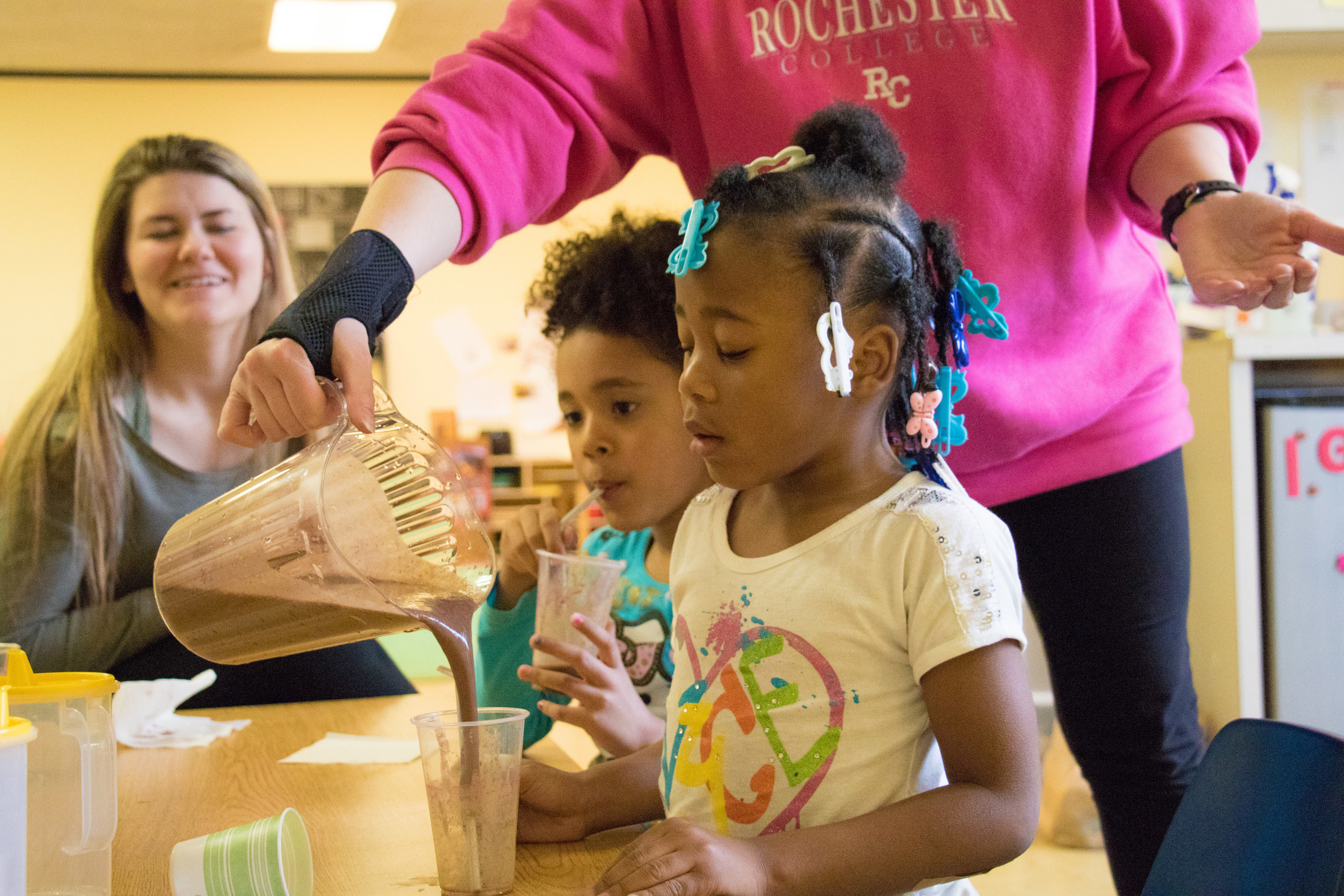 """Brianna, 5, is a participant in Save the Children's smoothie program at her daycare at Alpha Montessori School at the YWCA in Flint, Mich. She just tried a new recipe, """"purple,"""" which is made of blueberries and spinach. She liked it so much, she asked for seconds. The Save the Children smoothie program is helping children to eat healthy, nutrient-rich foods to mitigate the impact of lead exposure. Save the Children is in Flint, responding to the water crisis. Alpha child care serves 90 children, over 60 of whom are from low-income, vulnerable families. Photo by Stuart Sia / Save"""
