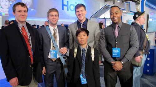The Ohio State University graduate students (left to right) Mac Carr, Nick Pochebly, Tina Li, Mack Lorden and Briun Greene take a break at the Consumer Electronics Show in Las Vegas. The students, who study Mandarin Chinese at OSU, were hired by the Chinese company Haier to work as liaisons and interpreters for the consumer electronics manufacturer. (PRNewsFoto/The Ohio State University MidWest US-China Flagship Program) (PRNewsFoto/THE OHIO STATE UNIVERSITY___)