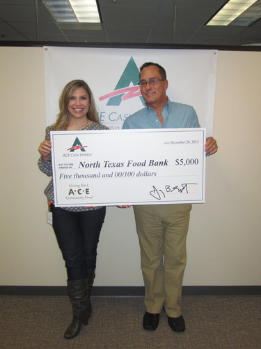 ACE's Charles Wilson presents North Texas Food Bank's Laura Besse with $5,000 donation.  ...