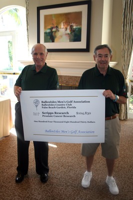 Jerry Pollack, Prostate Cancer Event Deputy and Burt Rein, MGA/Prostate Cancer Committee Chair holding the record donation the BallenIsles Men's Golf Association presented to Scripps Research.  (PRNewsFoto/BallenIsles Country Club)