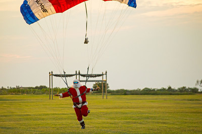 Santa parachuted in to a large crowd at Moody Gardens for the Opening Ceremony of Festival of Lights in Galveston, TX.