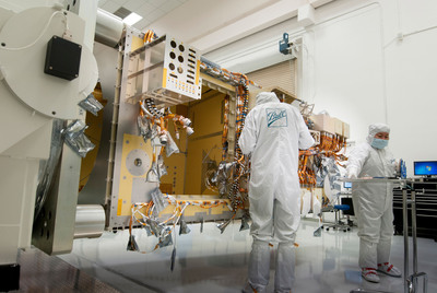 Ball Aerospace technicians install wire harnessing on the Joint Polar Satellite System-1 satellite. Ball has completed the SpaceWire Inter-operability test for the spacecraft and begun bus integration. The spacecraft will be powered-up for the first time in mid-February as build progresses toward an early 2017 launch.  (PRNewsFoto/Ball Aerospace & Technologies Corp.)