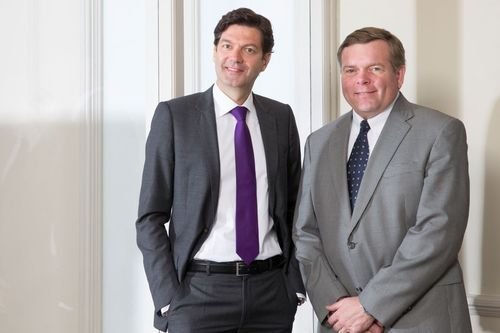 """Marc Krauth (left) and Clark Halladay: ...""""Consolidate our position as global leader in carpet tile backing and automotive markets""""... (PRNewsFoto/Bonar)"""