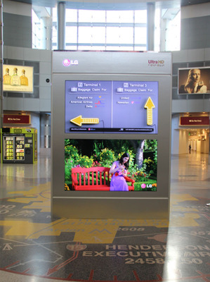 Boasting 8 million pixels -- four times the resolution of traditional HD displays -- LG Electronics' 84-inch class Ultra HD Signage Display is already attracting attention in the first-ever installation of 4K digital signage at Las Vegas' McCarran International Airport.  Two LG 84-inch UHD  displays with stunning 4K content are featured in a new wayfinder kiosk in McCarran Airport's D Concourse, where nearly 32,000 passengers pass through its 45 gates on a daily basis.  (PRNewsFoto/LG Electronics USA)