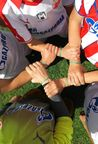 The official symbol of the International Day of Football and Friendship - Friendship bracelet - on the hands of participants