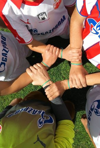 The official symbol of the International Day of Football and Friendship - Friendship bracelet - on the hands of participants (PRNewsFoto/FOOTBALL FOR FRIENDSHIP)