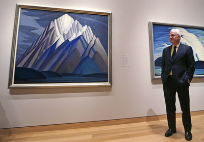 Steve Martin, co-curator of the exhibition The Idea of North: The Paintings of Lawren Harris, stands next to Mountain Forms during a preview at the Museum of Fine Arts, Boston (Photo Credit: Charles Krupa/Associated Press)