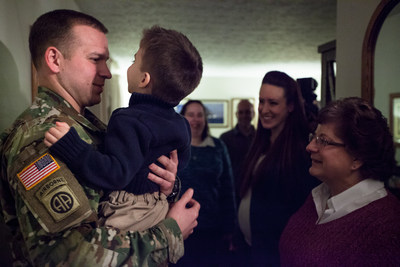 Kevin Patrick, Active US Army Airborne, greets his family in Rochester, NY. His parents Wade and Brenda Patrick thought Ashley Furniture was at the door to complete their home makeover, but instead were stunned when their son surprised them, who hasn't been home for Thanksgiving since he joined the Army.