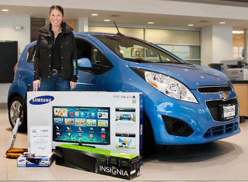 Lauren Cangilla was the winner of a new high-definition TV and Blu-ray player thanks to her support of the Chevrolet Youth Baseball program.  (PRNewsFoto/Bill Jacobs Automotive Group)