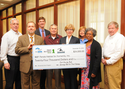 In a check presentation ceremony on Tuesday, November 10, Panola Habitat for Humanity received a $24,000 grant from Guaranty Bank and Trust Company, First Security Bank, and Federal Home Loan Bank of Dallas. Batesville, Mississippi Mayor Jerry Autrey (pictured on right) was in attendance.