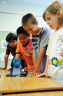 "Camp Invention, the nation's premier summer enrichment day camp, focuses on science, technology, engineering, and math (STEM) and encourages creativity and curiosity for youth during summer vacation in order to prevent ""summer slide."" (PRNewsFoto/Camp Invention)"