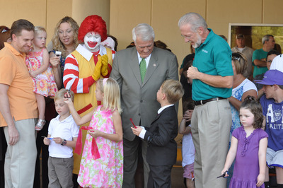 Congressman John Carter, District 31 (left), shares a smile with Ronald McDonald and John Boyd III, MD, CEO and chief medical officer of Children's Hospital at Scott & White (right) as former pediatric patients cut the ribbon to officially welcome the community to an open house. The hospital begins treating patients October 4. (PRNewsFoto/Scott & White Healthcare)