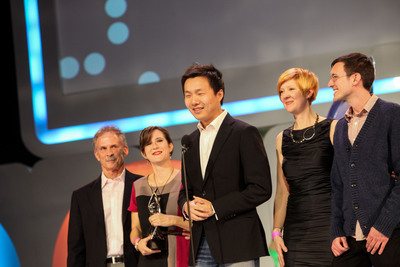 LAS VEGAS - the team from thatgamecompany accepts Game of the Year honors for Journey at the 2013 D.I.C.E. Awards. From left to right: Tom Frisina, Kellee Santiago, Jenova Chen, Robin Hunicke, Martin Middleton.  (PRNewsFoto/Academy of Interactive Arts & Sciences)