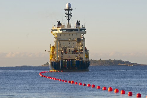 Cinia Group begins laying a new submarine data cable Sea Lion in Helsinki, Finland on October 12, 2015. The Helsinki end of the cable is brought to shore from cable laying ship Ile de Brehat. The new fiber optic cable will cross the Baltic Sea from Helsinki to Rostock, a distance of 1,170 kilometers. Planned to be in operation in Spring 2016, the sea cable will provide a new direct and cyber secure data connection between Finland and Germany. (PRNewsFoto/Cinia Group) (PRNewsFoto/Cinia Group)