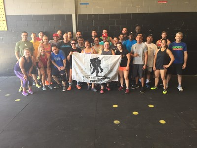 Warriors pose after a day of fitness training hosted by Wounded Warrior Project.
