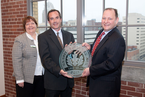 Renae Hesselink, Chair & Founding Member, Regional USGBC and Paul Jacob, Vice President of Project Planning for Christman Co. present the LEED Gold Certification award to Steve Reynolds, Vice President of Corporate Services for Accident Fund Holdings, Inc.  (PRNewsFoto/Accident Fund Holdings, Inc.)