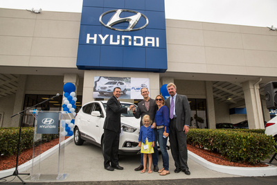 Tustin Hyundai celebrates the first Hyundai Tucson Fuel Cell customer, Timothy Bush, with a key hand-off ceremony at the dealership. The Tucson Fuel Cell vehicle is the first mass-produced fuel cell vehicle offered in the U.S. market. The hydrogen-powered vehicle is available for lease in Los Angeles and Orange Counties of Southern California, which have the greatest density of hydrogen stations in the U.S. (PRNewsFoto/Hyundai Motor America)