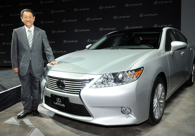 Akio Toyoda, president of Toyota Motor Corporation, stands with a Lexus ES 350, which will be built at the Georgetown, Ky., plant starting in 2015. Senior executives in New York and Kentucky made the announcement April 19, 2013.   (PRNewsFoto/Toyota)