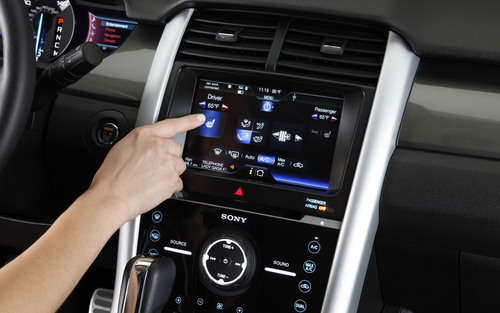 The Ford MyTouch interface will switch some of its controls to knobs and buttons.  (PRNewsFoto/Maritime Ford)