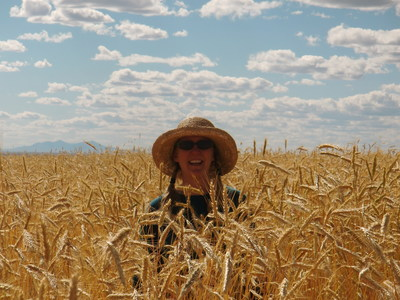 Anna Jones-Crabtree, Montana Organic Association member who introduced the motion to join FAC, stands neck-high in a field of organic grain in Montana