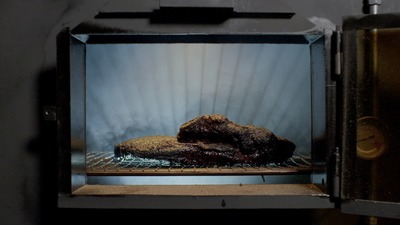 Arby's brisket during the last hour of smoking. (PRNewsFoto/Arby's Restaurant Group, Inc.)