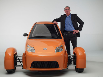 Paul Elio with the Elio prototype.  (PRNewsFoto/Elio Motors)