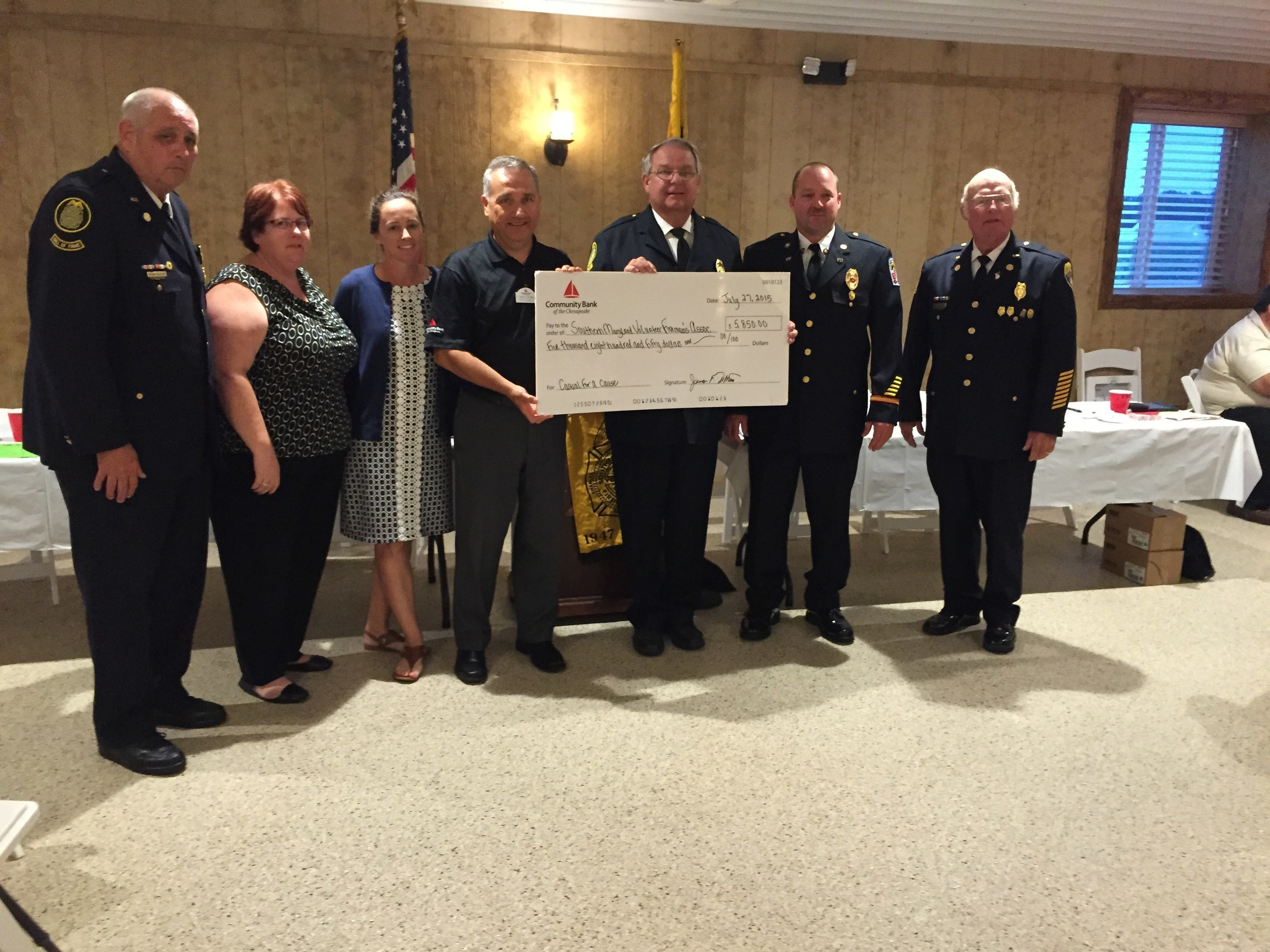 Representatives from Community Bank of the Chesapeake present the donation check to the Southern Maryland Volunteer Firemen's Association.