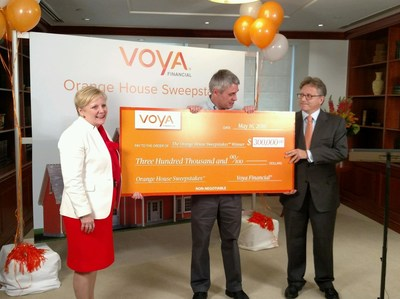 Voya executives Karen Eisenbach (left) and Alain Karaoglan (right) help Orange House Sweepstakes™ winner Kevin Martin (center) build a solid foundation for his retirement with a $300,000 prize.