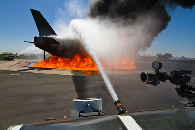 Dallas/Fort Worth International Airport dedicated its newly renovated Fire Training Research Center, establishing one of the world's top facilities for aircraft rescue firefighting training and research.  Here, firefighters attack a demonstration fire at the Airport's new burn pit, which features a replica mockup of an Airbus A380.  (PRNewsFoto/DFW International Airport)