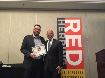 Stratalux CEO, Jeremy Przygode, accepts the Red Herring North America Top 100 Award