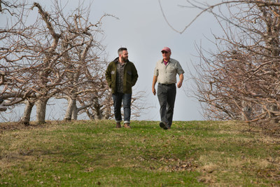 Angry Orchard Cider Maker Ryan Burk and Apple Grower Jeff Crist examining the orchard grounds at the beginning of this year's apple growing season