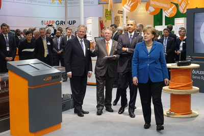 Andreas Lapp and Siegbert Lapp of the Lapp Group meet President Barack Obama and Chancellor Angela Merkel at the Hannover trade fair for industrial technology.