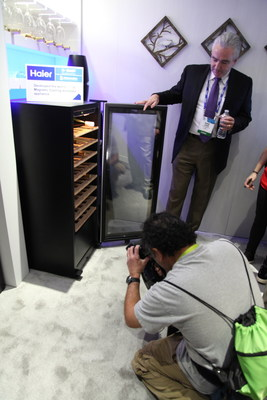 """Haier Presents the World's First """"No-Compressor Wine Cabinet"""" at 2015 CES. (PRNewsFoto/Haier)"""