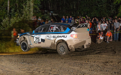 Subaru Rally Team USA driver David Higgins flies through the night amid spectators at Ojibwe Forests Rally.