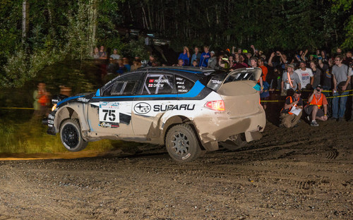 Subaru Rally Team USA driver David Higgins flies through the night amid spectators at Ojibwe Forests Rally. ...