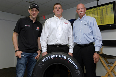 """(Left to right) NASCAR driver Matt Kenseth, Medal of Honor recipient Sgt. Dakota Meyer and Stu Grant, Goodyear general manager of global race tires, unveil Goodyear's 2014 """"Support Our Troops"""" race tire which will be used during all NASCAR races leading up to Memorial Day at Charlotte Motor Speedway.  The custom tires will coincide with the launch of Goodyear's fifth annual """"Goodyear Gives Back"""" campaign-a charitable program benefiting the Support Our Troops Organization, a nonprofit nationwide organization that works to bolster the morale and well-being of America's troops and their families. (PRNewsFoto/The Goodyear Tire & Rubber Co.)"""