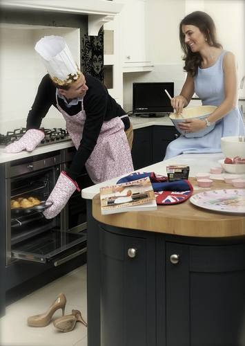 Wills practicing his birthday cake making skills ahead of George's first birthday, while Kate kicks backs and licks the bowl. Will Mary Berry and Paul Hollywood be seeing Will in the next Great British Bake Off? (PRNewsFoto/Betta Living)