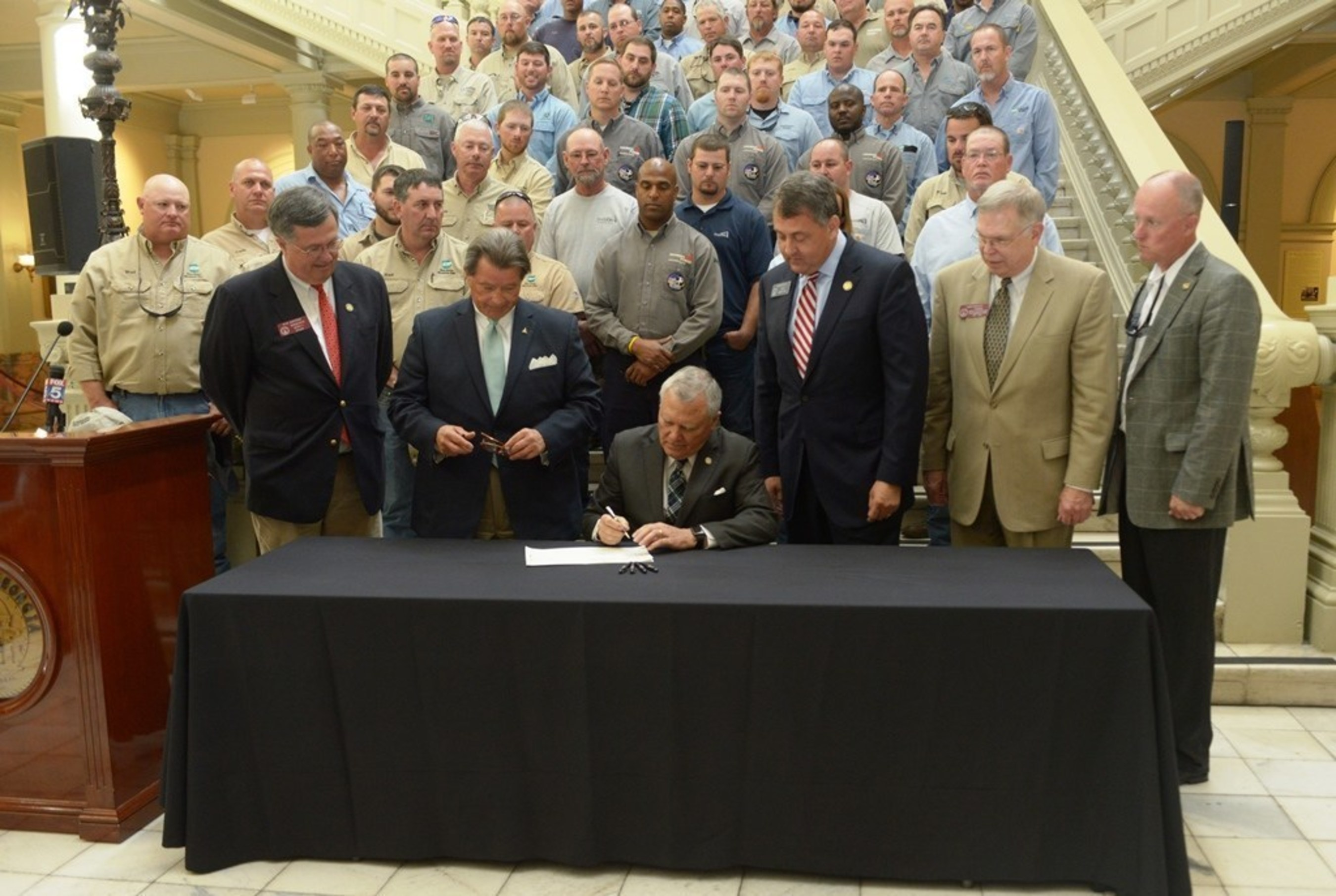 """Governor Nathan Deal marks Lineman Appreciation Month by signing House Bill 767 into law Tuesday. The legislation adds utility vehicles and workers to an existing law which requires drivers to """"move over"""" one lane."""