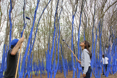 Volunteers color trees for artist Konstantin Dimopoulos' installation of The Blue Trees in Houston, Texas, as part of Houston Arts Alliance's commitment to public art.  (PRNewsFoto/Houston Arts Alliance)