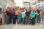 Employees from BorgWarner's manufacturing facility in Seneca, South Carolina, proudly display their latest Excellence in Quality Award from Honda North America. Since 2002, the plant has earned 12 supplier awards from Honda, including seven awards for quality, four for delivery and one for engineering innovation.